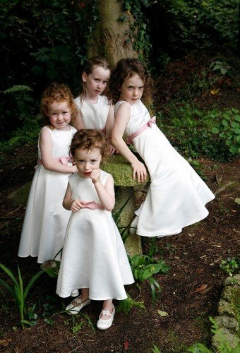 group of flowergirls, flower fairies, fairytale wedidng, flowergirl dresses, pink sashes, flowergirl shoes.