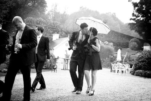 couple kissing unbrella, black and white wedding, real wedding Ballybeg House Hotel Arklow, rainy day wedding