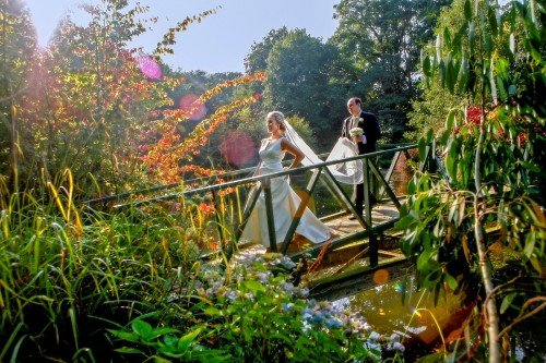 Marlfield House real wedding, bride and groom on bridge, veil shot, flowers,