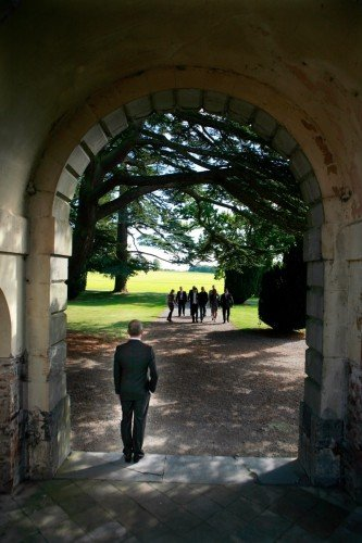 real wedding, Carton House, groom in arch, reportage, natural shot, backlit, wedding documentary style
