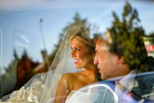 Bride with Dad through car window, Bride in wedding car, Bride and Dad natural moment,
