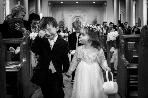 pageboy and flowergirl, pageboy and flowergirl moment, pageboy and flowergirl coming down the aisle, Pageboy crying at wedding