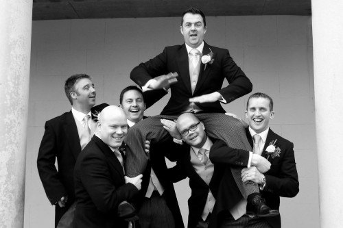 guys having fun at wedding, groom & groomsmen, fun wedding, real wedding, Carton House, black & white, fun shot, action shot, reportage