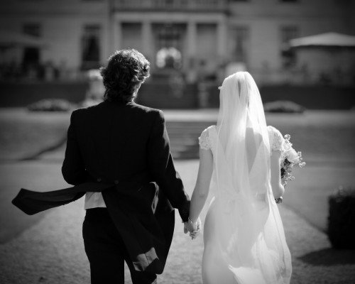 Veils and Tails, bride and groom walking, St Helens Radisson Blu, real wedding, documentary style, natural, reportage, candid, black and white,