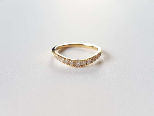 Tapered diamond set curved wedding band