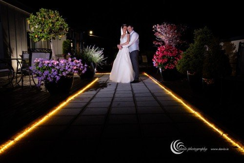 Trim Castle Hotel bride and groom at night
