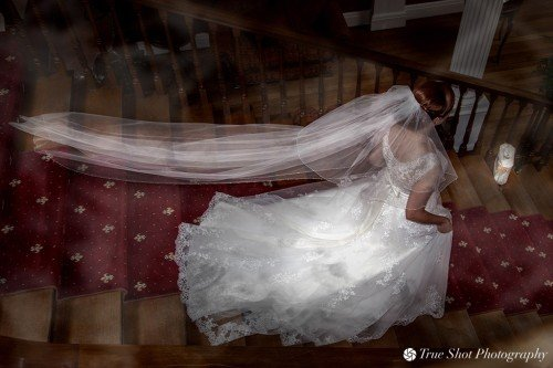 Bride walking down the staircase at Palmerstown Estate