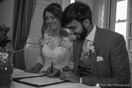 Bride and Groom signing the register at Ardgillan Castle