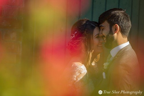 Bride and Groom sharing a tender moment after their ceremony at Ardgillan Castle