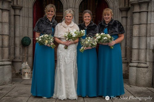 Bride and bridesmaids outside St. Aidans church