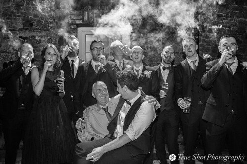 Wedding party smoking cigars
