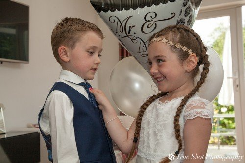Flower girl and page boy getting ready