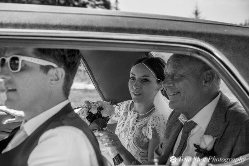 Bride arriving at ceremony with her father in the bridal car
