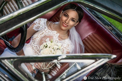 Bride in her bridal car