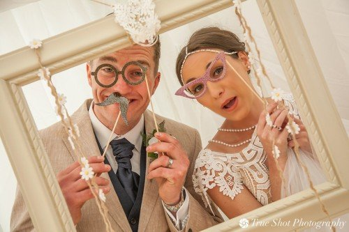 Bride and Groom with photo booth props