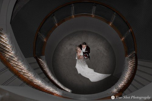 Bride and Groom at bottom of spiral staircase at Druids Glen