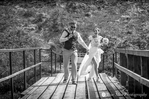 Bride and Groom on the wooden walkway at Kippure Estate