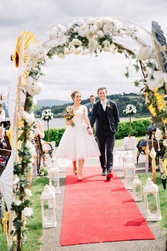 Outdoor Wedding 'walking down the aisle' - The Avon Lakeshore Wedding Venue
