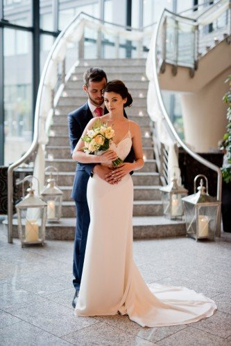 Wedding Couple at foot of staircase