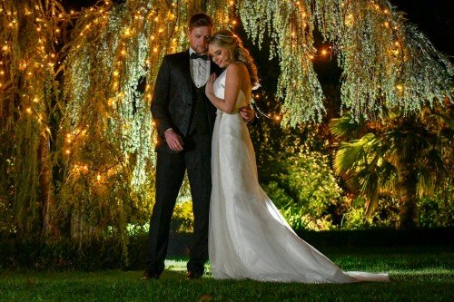Wedding Couple by willow tree at night in Clanard Court Garden