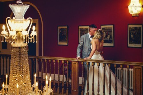Wedding Photographer captures newlyweds secret kiss at the Palmerstown House Estate