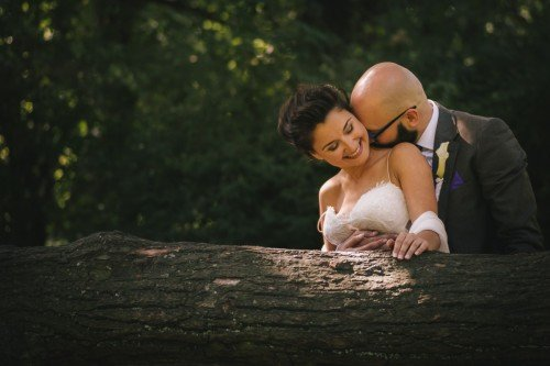 Young newly married couple kissing romantically at the wedding photo shoot session