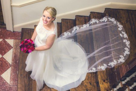 beautiful bride in her white wedding dress walking down the stairs at The Royal Hospital, Kilmainham