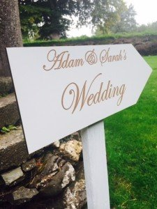 Directional arrow wedding sign