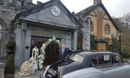 Our General Manager, Matthias Muller, with one of our wedding cars/ Hotel Wedding Venues | Great National Abbey Court Hotel