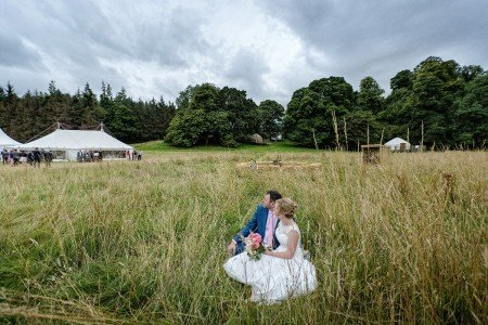 Newlyweds enjoying the view from the Meadow