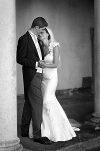 Bride and Groom Kiss, fishtail dress, Groom in tails, Carton House real wedding, documentary style, natural, reportage, candid, black and white,