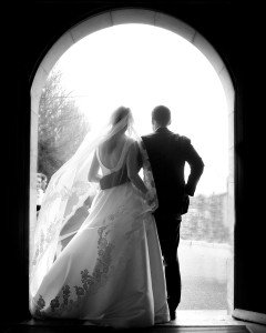 silhouette of couple in church door, d silhouette of Bride and Groom at Church, documentary style, natural, reportage, candid, black and white,
