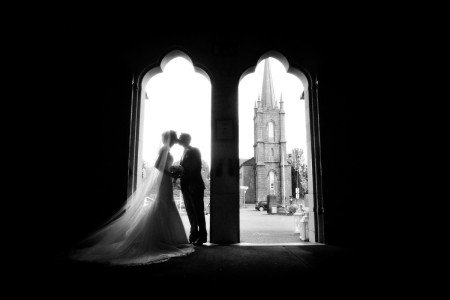 silhouette of couple in church door, silhouette of Bride and Groom at Church, documentary style, natural, reportage, candid, black and white, romance, creative