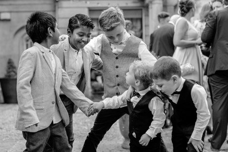 Pageboys having fun, pageboy outfits, Marlfield House real wedding, documentary style, natural, reportage, candid, black and white,