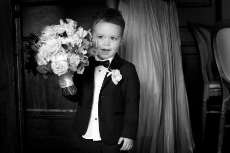 Pageboy with bouquet, black & white, documentary natural style