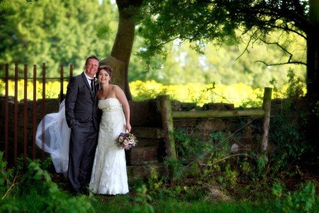 Bride and Groom by wedding gate, fence, countryside, real wedding, Bellinter House wedding, backlight