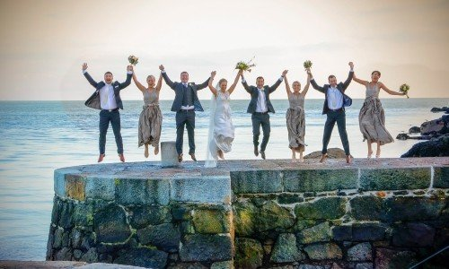 bridal party jump, bridal party on pier, starjump, silhouette of bridal party, dalkey harbour